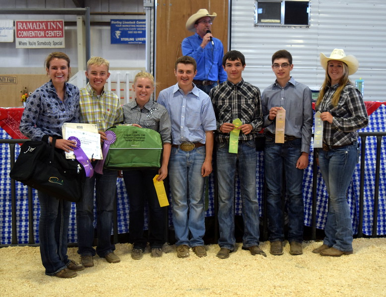 Senior showman competitors in the Round Robin Showmanship Contest Friday, Aug. 5, 2016, at the Logan County Fair. From left; Kristi Cook, master showman; Cooper Carlson, reserve master showman; Kinlie Lewis, fifth place; Riley Meisner, sixth place; Tyler Gentry, seventh place; Jayce Maker, eighth place; and Bailey Nelson, ninth place. Not pictured, Cassidy Paxton, third place, and Abbey Brower, fourth place.