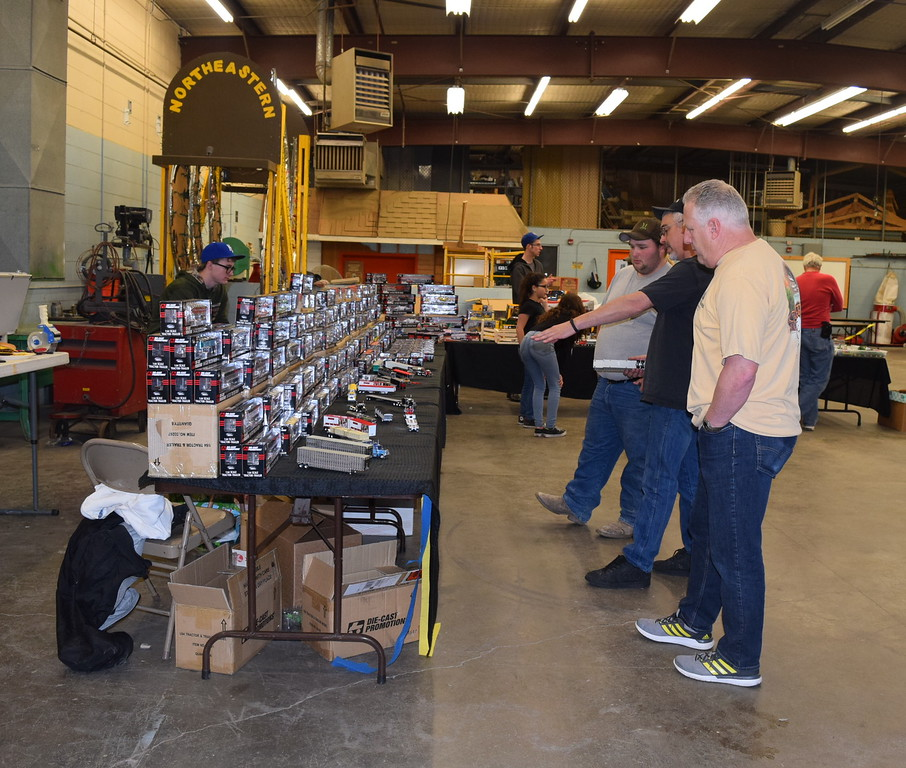 Guests look over items available for purchase at the NJC Diesel Power Club Toy Show Saturday, April 2, 2016.