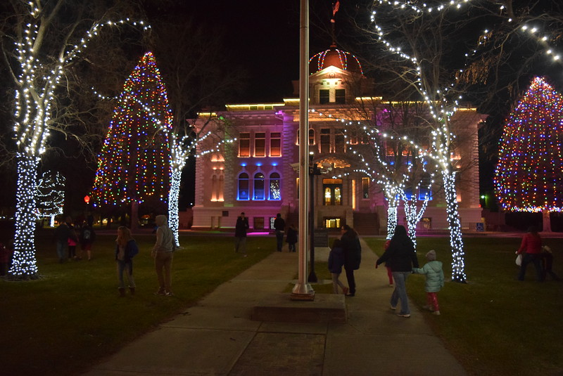 Paradegoers enjoy the Logan County Courthouse lights following the Parade of Lights Thursday, Nov. 30, 2017.