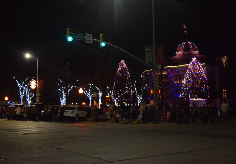 A crowd gathers in front of the Logan County Courthouse before the start of the Parade of Lights Thursday, Nov. 30, 2017.