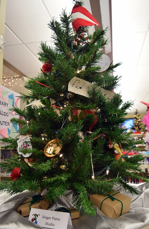 . Singer Piano Studio\'s tree at Sterling Public Library\'s 2017 Parade of Trees.