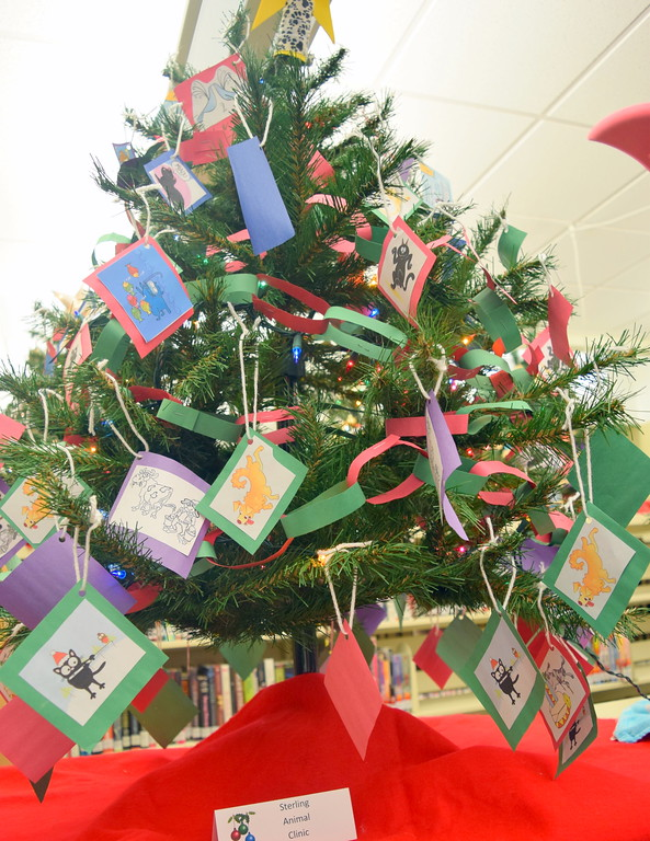 . Sterling Animal Clinic\'s tree at Sterling Public Library\'s 2017 Parade of Trees.
