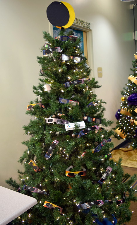 . Sterling Public Library\'s eclipse themed tree tree at Sterling Public Library\'s 2017 Parade of Trees.