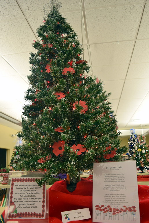 . Tricia Ketchum\'s tree at Sterling Public Library\'s 2017 Parade of Trees shares information about the Rememberance poppy.