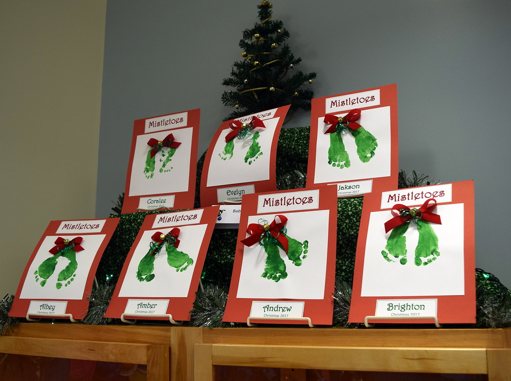 . Christmas tree ornaments made by children are on display in Sterling Public Library\'s Parade of Trees.