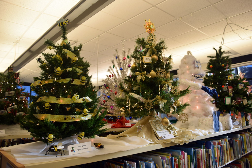 . Christmas trees from Busy Bee Homemakers, PEO and Sterling Fire Department on display at Sterling Public Library\'s 2017 Parade of Trees.