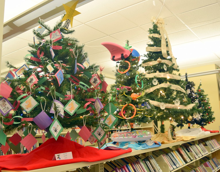 Christmas trees fill Sterling Public Library for the 2017 Parade of Trees.