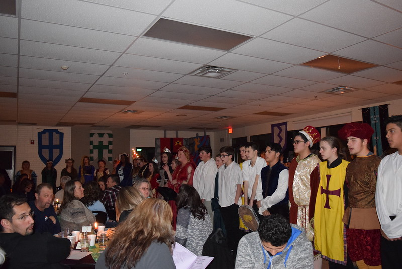 "Sterling High School's Concert Choir performs ""We Wish You a Merry Christmas,"" under the direction of Annette Lambrecht, at the school's 30th annual Madrigal Dinner Monday, Dec. 4, 2017."