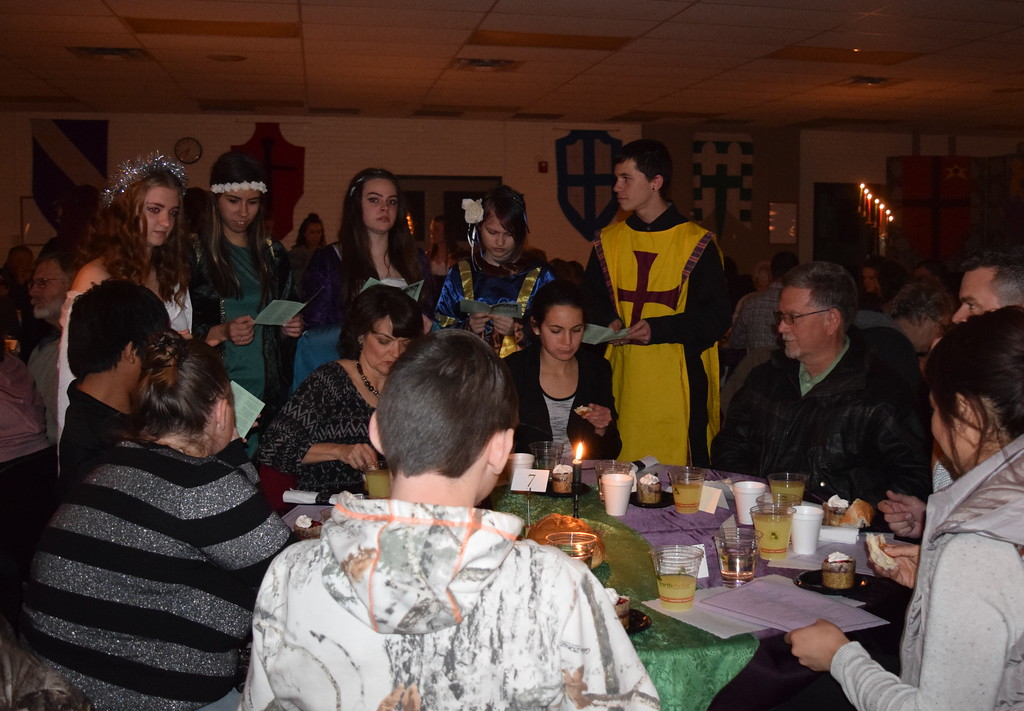 . Wandering minstrels provide musical entertainment for tables as they enjoy their food at Sterling High School\'s 30th annual Madrigal Dinner Monday, Dec. 4, 2017.