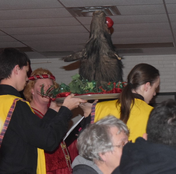 The boar's head is carried into the Grand Hall (cafeteria) signaling the start of the feast at Sterling High School's 30th annual Madrigal Dinner Monday, Dec. 4, 2017.