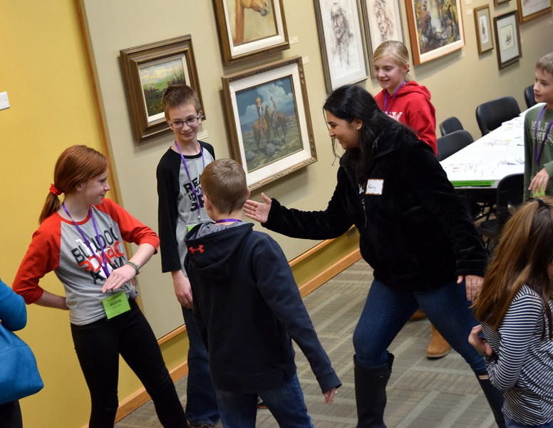 A University of Colorado Boulder student helps elementary students as they participate in a game of Ninja, where two germs took on three white blood cells, during a workshop at a Brain Awareness Day presented by the Intermountain Neuroimaging Consortium Friday, Feb. 8, 2019.