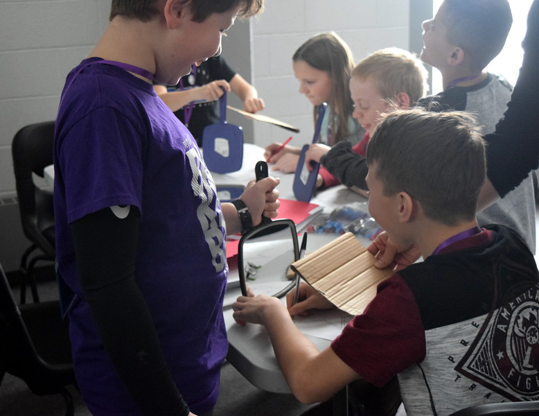 Students test their memory skills as they try to draw a star using a mirror during one of the workshops at Brain Awareness Day presented by the Intermountain Neuroimaging Consortium Friday, Feb. 8, 2019.