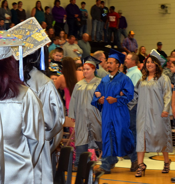 Caliche High School graduates make their way into the gym at the start of commencement exercises Saturday, May 27, 2017.