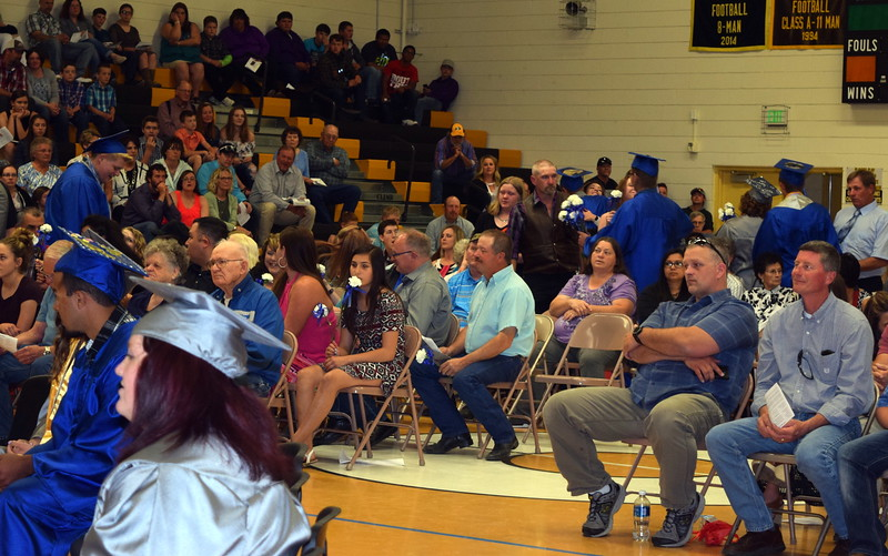 Caliche High School graduates present flowers to family and friends during the school's commencement exercises Saturday, May 27, 2017.