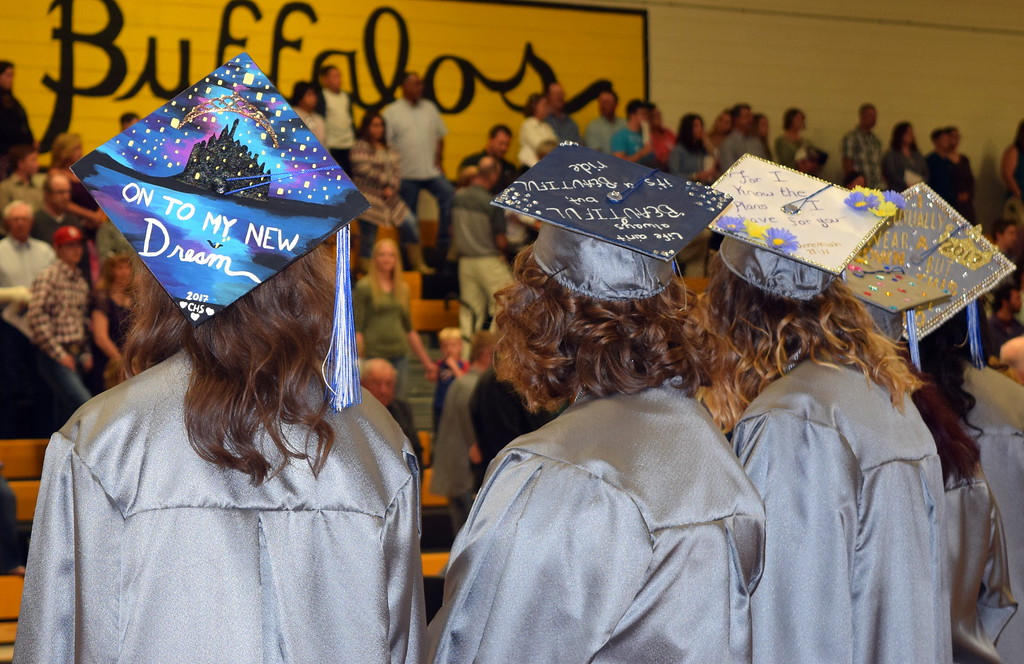 . Caliche High School graduates decorated their caps with different messages for commencement exercises Saturday, May 27, 2017.
