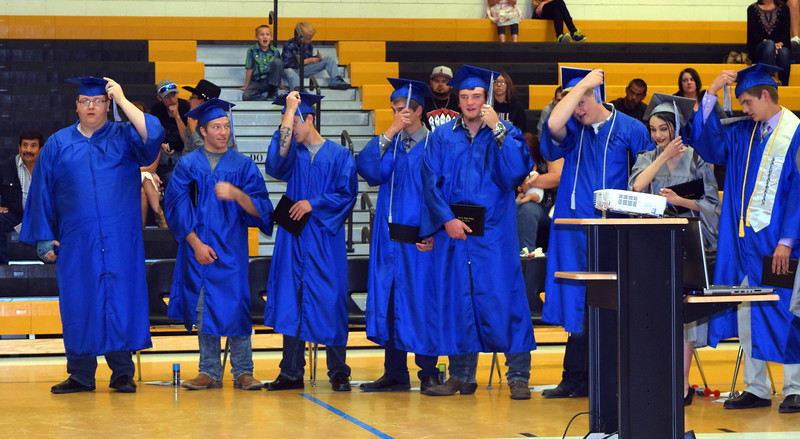 Caliche High School graduates flip their tassels at the school's commencement exercises Saturday, May 27, 2017.