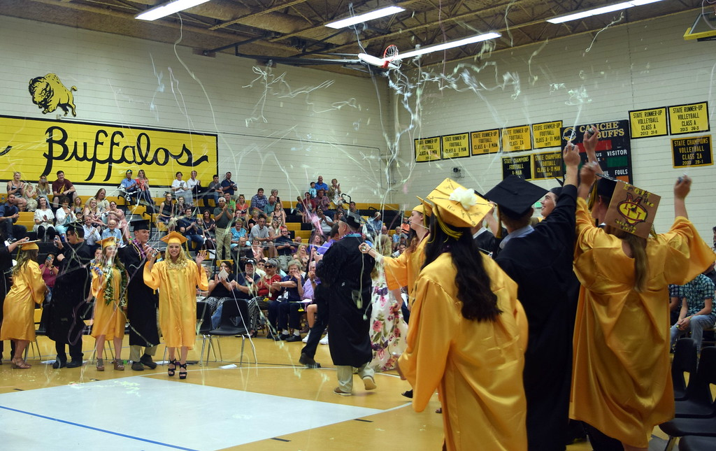 . The Caliche High School Class of 2018 celebrates with silly string at the conclusion of the commencement exercises Saturday, May 26, 2018.
