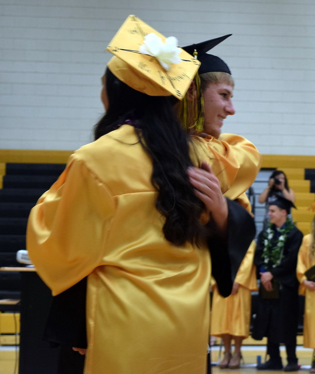 . Caliche High School graduates give out hugs after receiving their diplomas during commencement exercises Saturday, May 26, 2018.