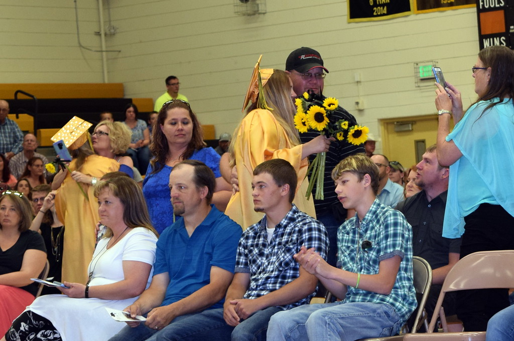 . Caliche High School graduates recognize family and friends with flowers during commencement exercises Saturday, May 26, 2018.