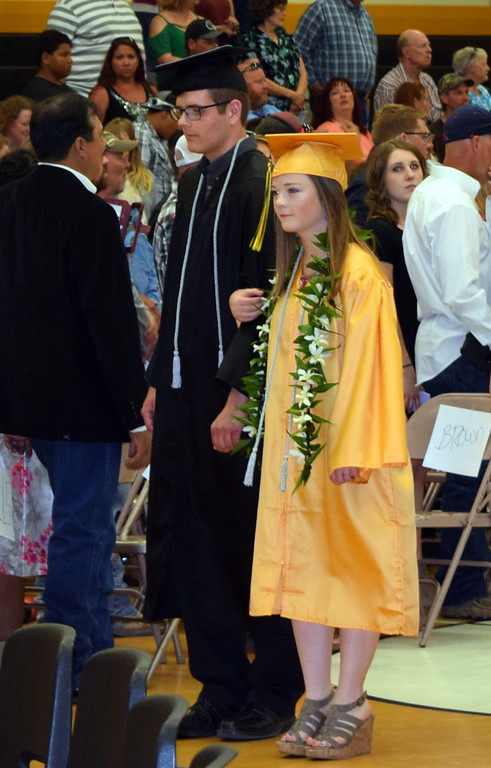 . Caliche High School graduates proceed into the gym at the start of commencement exercises Saturday, May 26, 2018.