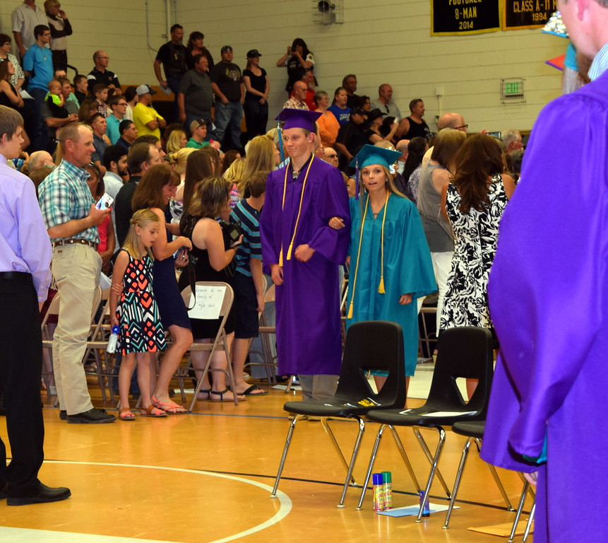 Graduates Isaac Schumacher and Jaedyn Lambrecht make their way into the gym at the start of Caliche High School's Commencement Exercises Saturday, May 28, 2016.