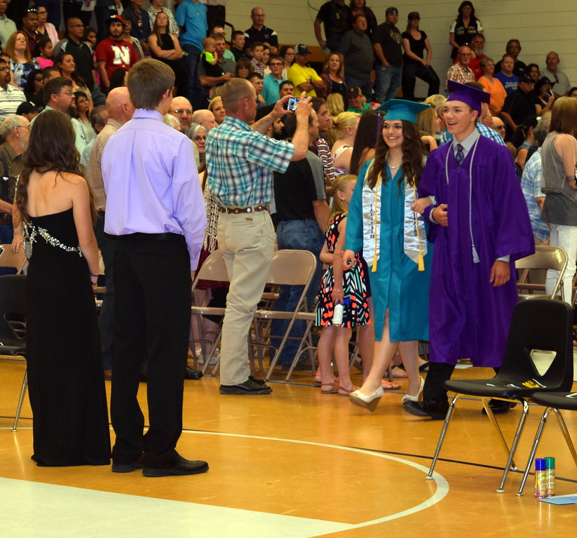 Graduates Emily Bournia and Kyle Etl make their way into the gym at the start of Caliche High School's Commencement Exercises Saturday, May 28, 2016.