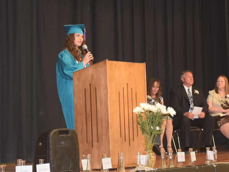 Salutatorian Emily Bournia gives the farewell address during Caliche High School's Continuation Exercises Saturday, May 28, 2016.