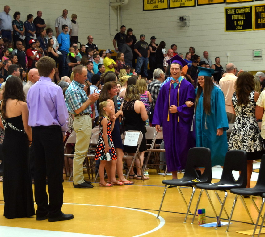 Graduates Bruce Taylor and Brandi Vigil make their way into the gym at the start of Caliche High School's Commencement Exercises Saturday, May 28, 2016.