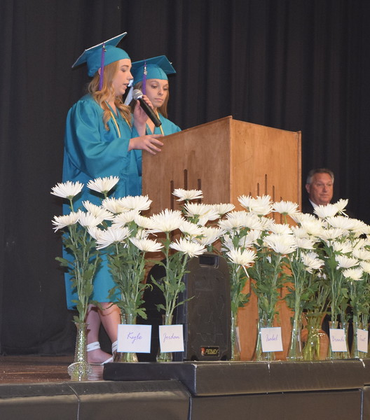 Rylie Lewis, left, and Jaedyn Lambrecht recognize parents of the graduates at Caliche High School's Continuation Exercises Saturday, May 28, 2016.
