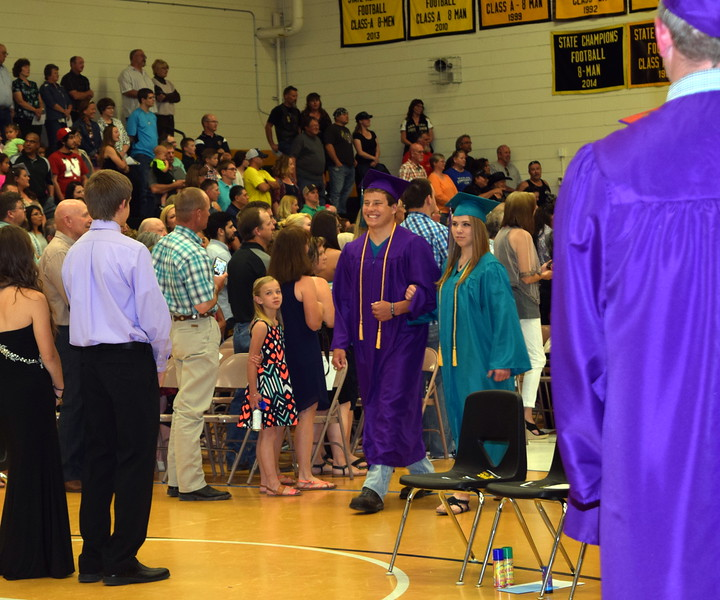 Graduates Derrick Pierce and Brandi Grauberger make their way into the gym at the start of Caliche High School's Commencement Exercises Saturday, May 28, 2016.