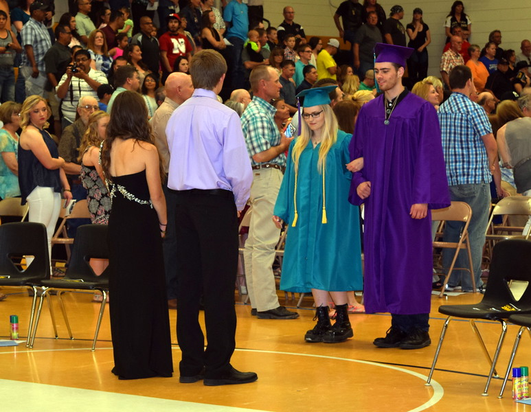 Graduates Sheila McCabe and Kyle Dowis make their way into the gym at the start of Caliche High School's Commencement Exercises Saturday, May 28, 2016.