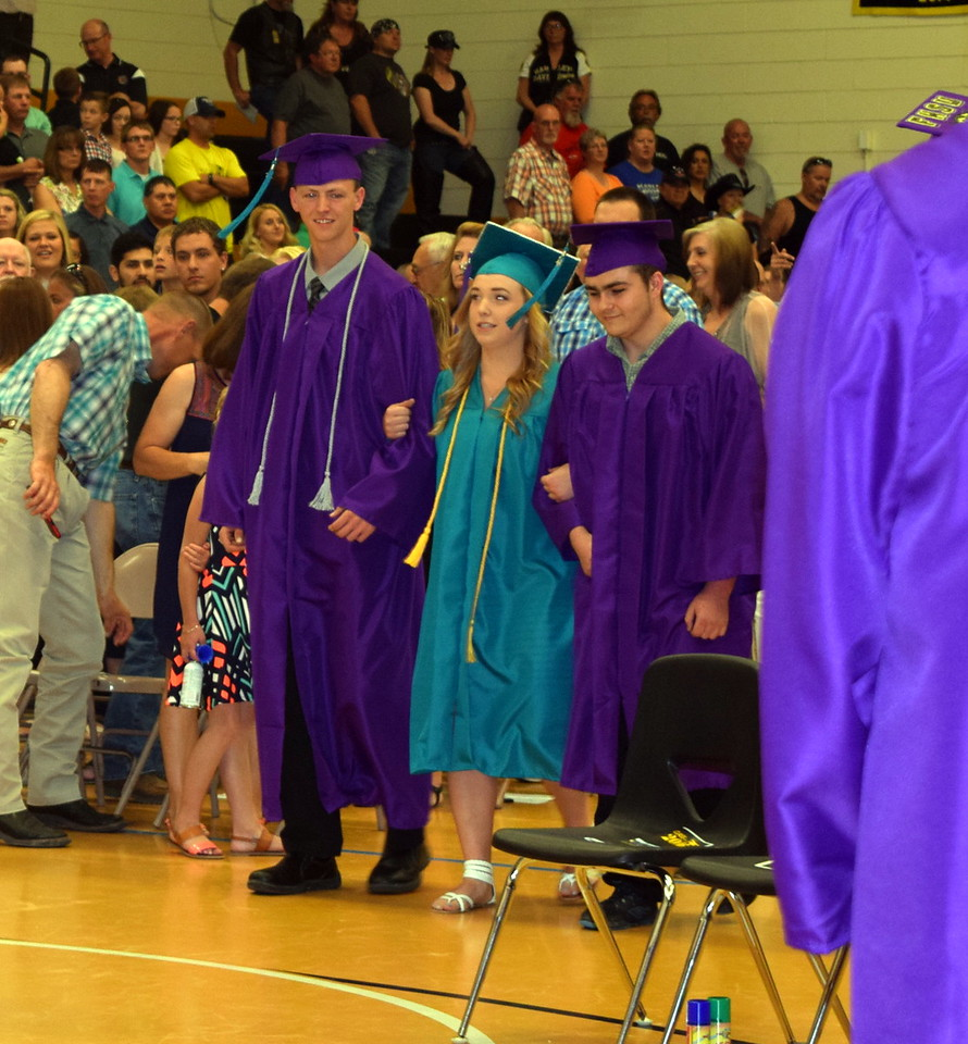 Graduates Trenton Chartier, Rylie Lewis and Donovan Hayes make their way into the gym at the start of Caliche High School's Commencement Exercises Saturday, May 28, 2016.
