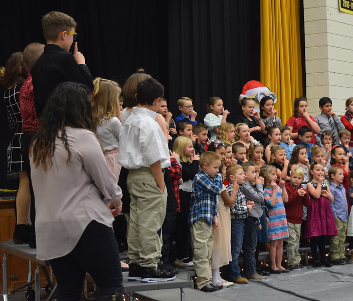 "Caliche Elementary kindergarten through fourth grade students perform ""Rudolph the Red Nosed Reindeer,"" under the direction of Ryan Rosete, Tuesday, Dec. 5, 2017, at the school's Christmas Celebration."