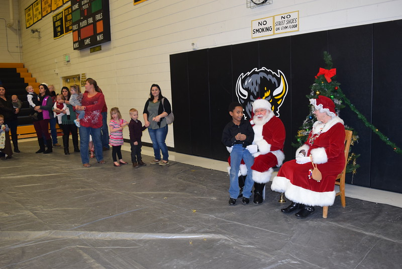 At the conclusion of Caliche School's Christmas Celebration, Monday, Dec. 5, 2016, children lined up to share their Christmas wishes with Santa and Mrs. Claus.