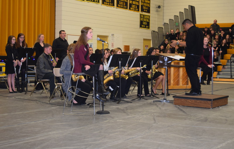 "The Caliche High School Band, accompanied by vocalists Rachel and Madison Fryrear, perform ""Sunday Morning,"" under the direction of Ryan Rosete, at the school's Christmas Celebration, Monday, Dec. 5, 2016."