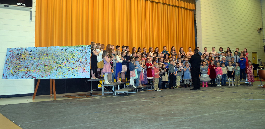 """. Caliche Elementary kindergarten through fourth graders perform \""""Try Everything,\"""" under the direction of Ryan Rosete, at the school\'s Visual and Performing Arts Show Tuesday, Feb. 26, 2019. Beside them is one of the visual art pieces that was on display."""
