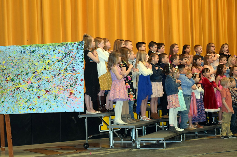 "Caliche Elementary kindergarten through fourth graders perform ""Try Everything,"" under the direction of Ryan Rosete, at the school's Visual and Performing Arts Show Tuesday, Feb. 26, 2019. Beside them is one of the visual art pieces that was on display."
