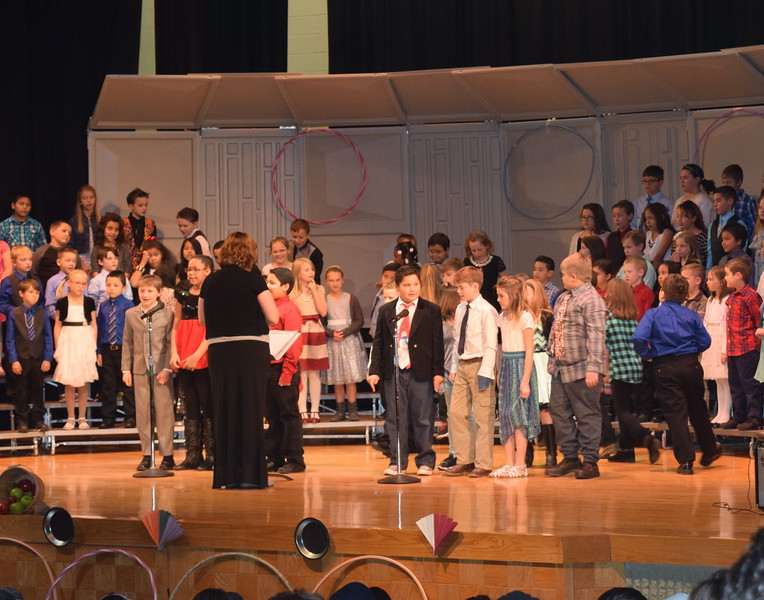 """Campbell Elementary third grade singers share some information about folk songs during their """"American Folk Songs"""" program Tuesday, Nov. 29, 2016."""
