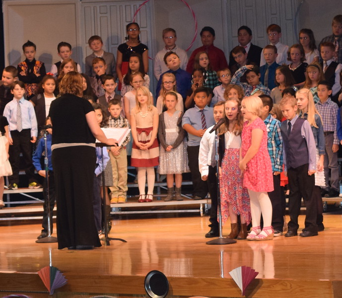 "Campbell Elementary third graders tell a joke during the school's ""American Folk Songs"" program Tuesday, Nov. 29, 2016."