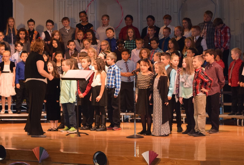 """Several third graders share some information about folk songs and games during Campbell Elementary's """"American Folk Songs"""" program Tuesday, Nov. 29, 2016."""