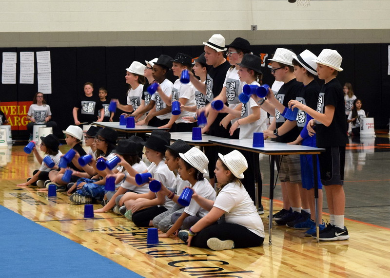 "Campbell Elementary fifth graders use cups to perform to ""We Will Rock You"" at the Music and P.E. Showcase Tuesday, March 6, 2018."