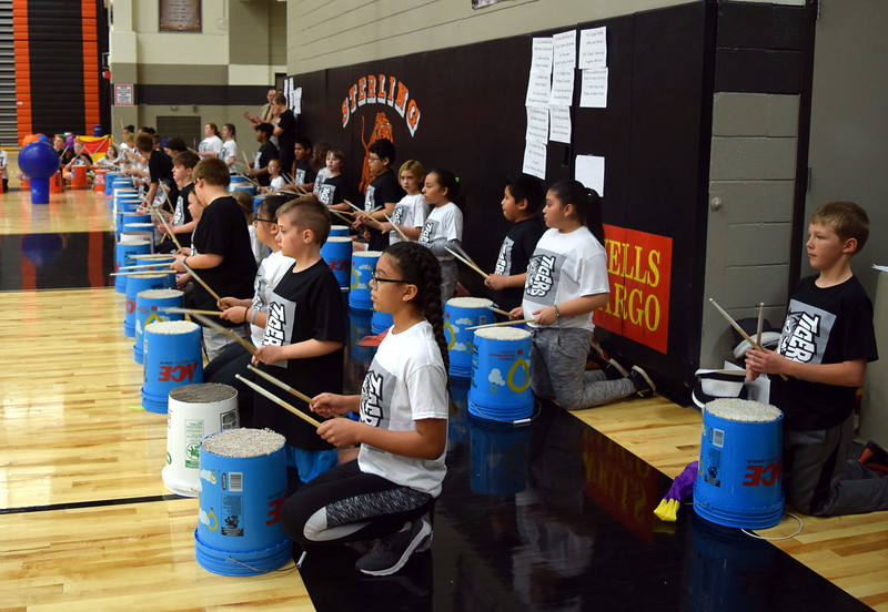 "Fifth graders pound bucket drums to ""We Will Rock You"" at Campbell Elementary's Music and P.E. Showcase on Tuesday, March 6, 2018."