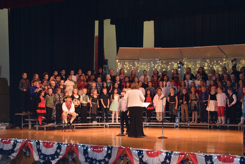 "Campbell Elementary fourth graders perform ""The Yuletide Blues,"" under the direction of Janelle Nicolaus, during the school's ""Yankee Doodle's Dandy Christmas"" program, Thursday, Dec. 8, 2016."