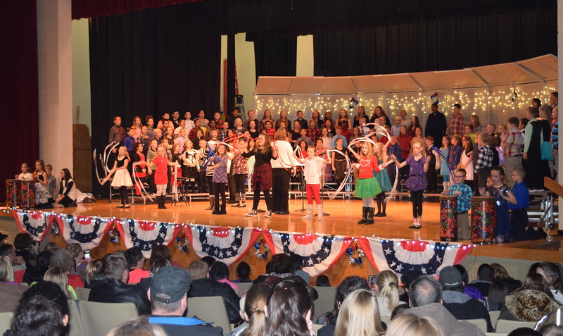 "Campbell Elementary fourth graders perform ""Welcome to America,"" under the direction of Janelle Nicolaus, during the school's ""Yanke Doodle's Dandy Christmas"" program, Thursday, Dec. 8, 2016."