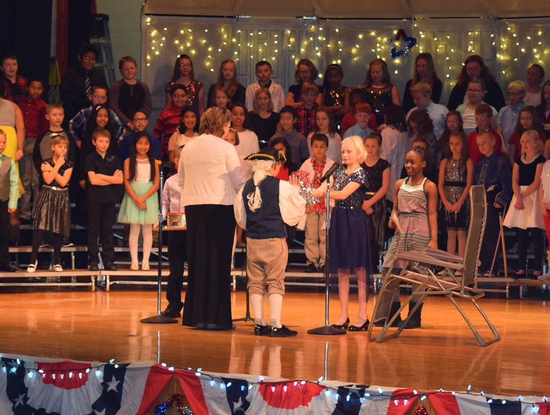 "Yankee Doodle gets a Christmas present at Campbell Elementary's ""Yankee Doodle's Dandy Christmas"" program, Thursday, Dec. 8, 2016."
