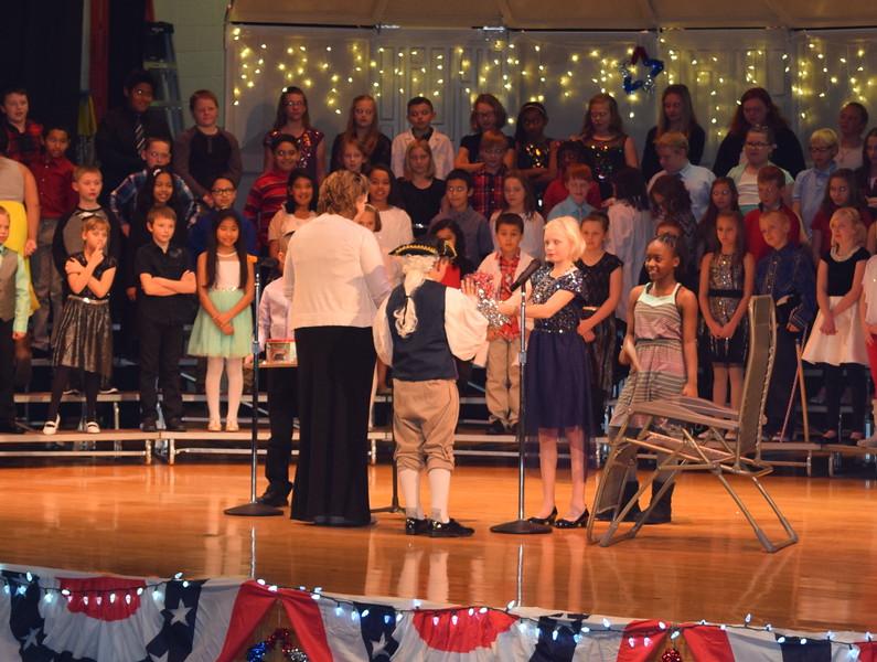 "Yankee Doodle gets a Christmas present at Campbell Elementary's ""Yankee Doodle's Dandy Christmas"" program, Thursday, Dec. 8, 2016."