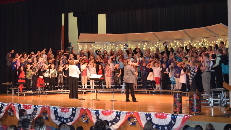 "Campbell Elementary fourth graders perform ""Merry Christmas to You from the Red, White, and Blue,"" under the direction of Janelle Nicolaus, during the school's ""Yankee Doodle's Dandy Christmas"" program, Thursday, Dec. 8, 2016."