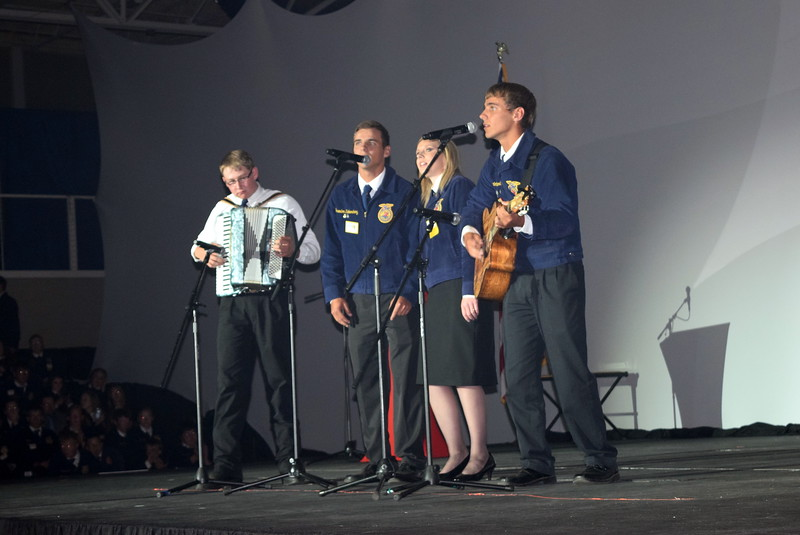 "Adam Davis, from the Peetz FFA chapter, Peyton and Braedon Kloberdanz, from the Sterling FFA chapter, and Caitlyn Ochsner, of the Platte Valley FFA chapter, perform ""Washed in the Blood"" during a talent show at the Colorado FFA State Convention Wednesday, June 8, 2016."