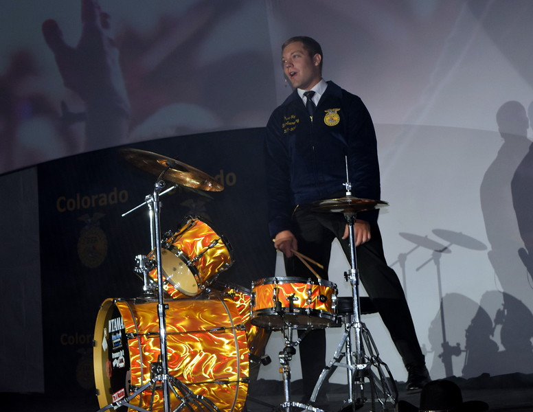 Colorado FFA State Secretary Bryce Funk, of New Raymer, gives his retiring remarks during the second session of the Colorado FFA State Convention Wednesday, June 8, 2016. He spoke about the importance of being yourself.