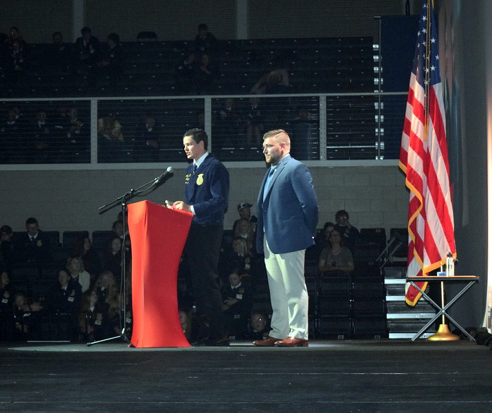 Colorado FFA State Sentinel Nick Vollmer, of Merino, is introduced by his brother and another Merino FFA member Gus Gill during the third session of the Colorado FFA State Convention Wednesday, June 8, 2016.